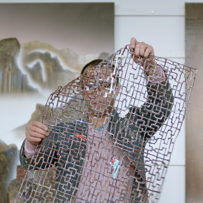 Gordon Cheung checking a frame