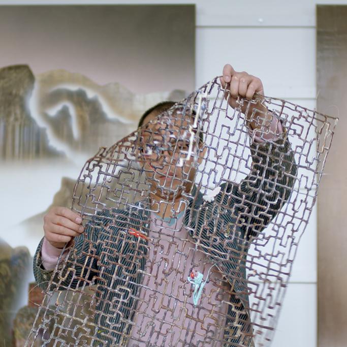 Gordon Cheung checking a frame