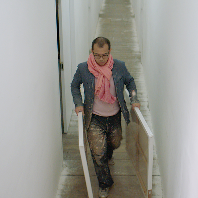 Gordon Cheung carrying frames